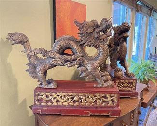 """ITEM 1: Magnificent pair of Chinese carved gilt wood dragons on red carved gilt wood bases. base: 7"""" x 23.325"""" 7.7625""""; dragon: 19.5"""" x 30"""" long, 7"""" wide  $650"""