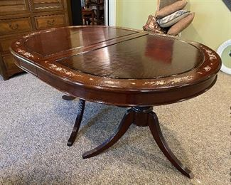 """ITEM 7: Mother of pearl inlay table, oval, measurement is smallest size. comes with two arm chairs and six side chairs. Chairs have solid wood seats, come with brocade custom seat cushions and feature mother of pearl inlay on both sides of center back. Two leaves 17.825"""" wide, as shown - 59"""" 3/8 x 30"""" tall, 44""""  $1,350"""