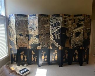 """ITEM 8: Monumental eight-panel black and gold folding screen; each panel separates from the others to be moved easily. each panel is 18"""" x 84"""" for a total of 126"""" wide when fully extended. $975"""