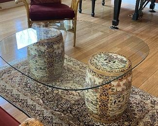 """ITEM 11: Pair of garden stools with custom cut tempered glass table top. Glass is 42"""" x 42"""" with very rounded corners, and a chip. $325"""