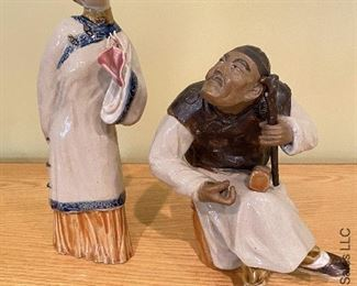 ITEM 17: Two ceramic Chinese figures. Female has damage to hands as shown.  $75