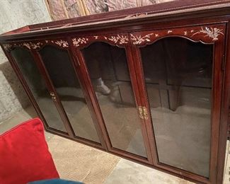 """ITEM 7A: Mother of pearl inlay two-piece display cabinet. Can be used together as a china cabinet, or with the base only as a sideboard. Matches table and chairs (item 7). 6'1"""" (L) X 14"""" (W) 6'10"""" (H) $950"""