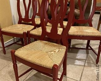 ITEM 18: Set of six red chairs with rush seats. Very good condition $500