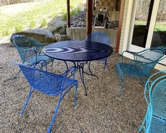 ITEM 23: Metal patio table with four chairs. All freshly painted in shades of blue, excellent condition.   $395