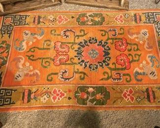 ITEM 35: Tibetan wool rug, orange, with bats. ~3'x5' $325