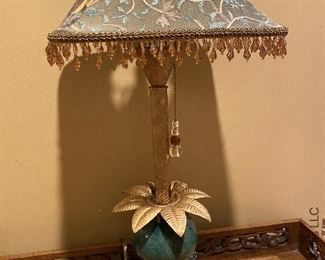 """ITEM 40: Table lamp, green ceramic base with gold laurel leaves. 23"""" x 10.75""""  $48"""