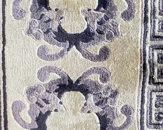 ITEM 45: Indigo blue/purple wool rug with bats, wool, hand-knotted. 7' x 11'  $1,200