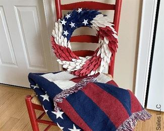 """ITEM 57: Red Ladder Back Rush seat chair (slight wear), Woven American Flag Throw 70""""X 49"""", Wood Curl Patriotic Wreath  $65"""