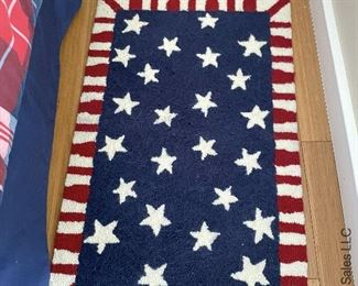 """ITEM 58: Hooked synthetic rug. Red,white & blue w/ stars. 21"""" x 31""""  $35"""