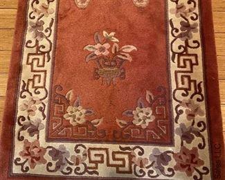 "ITEM 73: Wool rug, rose and beige. 120"" x 30""   $495"