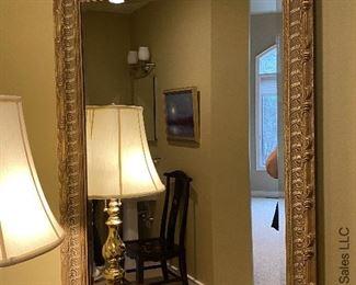 "ITEM 81: Beveled edge framed mirror 42"" (L) X 29"" (W)    $95"