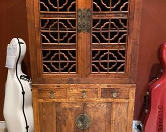 ITEM 83: Carved open door Antique Chinese Armoire  $1,400