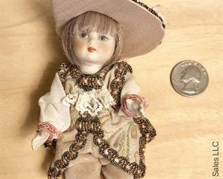 ITEM 106: two small porcelain dolls  $20