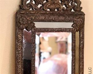 ITEM 130: decorative mirror with ornate metal work  $55
