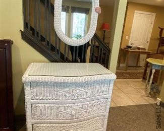 ITEM 135: Wicker dresser with custom cut glass top, and matching wicker rimmed mirror  $135