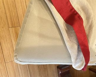 ITEM 139: Set of 8 Pottery Barn parsons chairs. Upholstered in khaki, slipcovered in beige linen with red trim.  Some minor wear damage consistent with age  $600