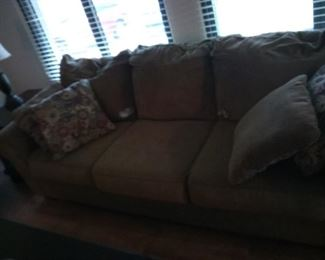6. Sofa was new until dog ate hole in 2 of the cushions. great buy for someone who can do mending $35 as is