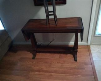 """antique entry table both end drop down. It is about 15"""" wide, 36"""" long and 25"""" tall price is $75. It is a Mahogany table from the 1940's"""