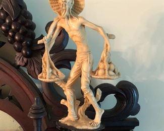 Carve Asian man figurine