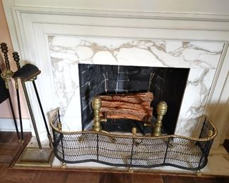 Fireplace surround, brass andirons, fireplace tools