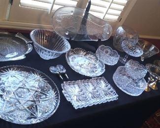 Cut crystal bowls and fish platters.