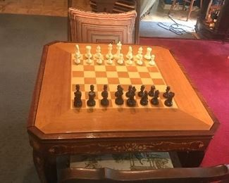 Great game table has separate top to use as a table. Chairs sold separately