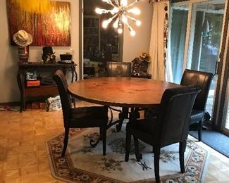 Custom made 8' round hammered Copper table with Croc fabric chairs