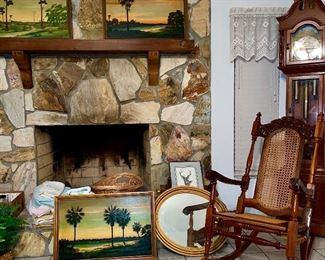 Early Highwaymen paintings by Clarence H. Alderman. Carved Dominican Republic + Cane (traditional Hole to Hole Lace Caning) Mahogany Rocking chair.  Emperor Grandfather Clock.
