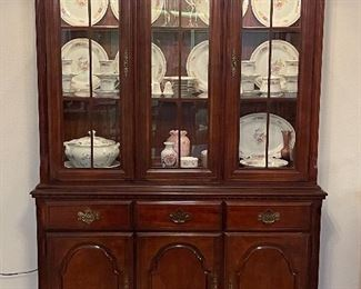 Thomasville, Cherry China Cabinet, lighted with 3 drawers and 3 doors with open storage.