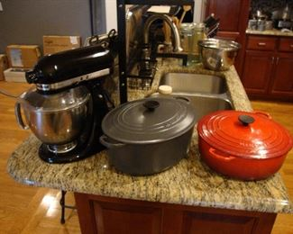 KitchenAid Artisan mixer with attachments.  Le Crueset #35 Oval Grey Dutch Oven Le Crueset #30 Round Red Dutch Oven