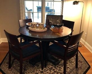 Round table with copper-color metal top, and 4 chairs