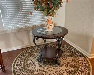 Lovely solid Wood accent table with inset glass top and wrought iron curved legs.