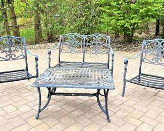 Metal 4 piece outdoor set.  Loveseat, 2 chairs and table.  No pads