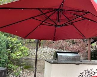 11 Ft. Offset Brick Color Umbrella with Base.  Solar.  One Broken Stay - Can be fixed.  Priced as is