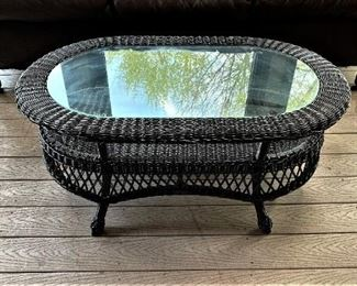 Small wicker table with glass top