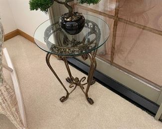 There are three of these glass-top iron tables in different sizes throughout the house.