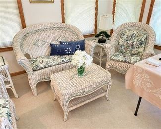 Lovely set of white wicker furniture. There are 8 pieces!