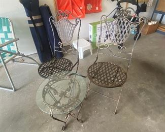 Pair of metal chairs and glass-top table