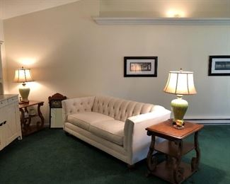 Beautiful Tufted Back Sofa in cream, Medium wood end tables with some fun ceramic green lamps!