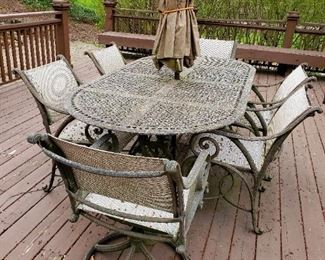 Patio table and chairs, needs be power washed, or enjoy the natural moss growth