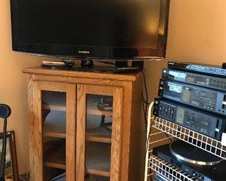 Samsung TV, Oak media cabinet with glass doors