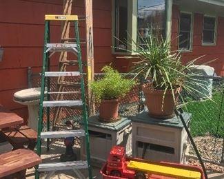 Ladders, Radio Flyer wagon, hose reels, plants, heated bird feeder