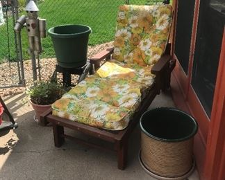 Vintage red wood chaise with wheels, garden pots