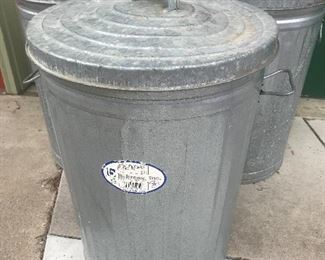 Galvanized trash cans with contents.....