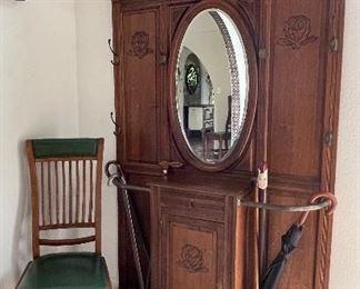 Very nice hall tree with oval beveled mirror