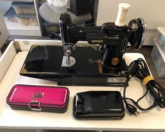 Singer Featherweight sewing machine with accessories and foot pedal