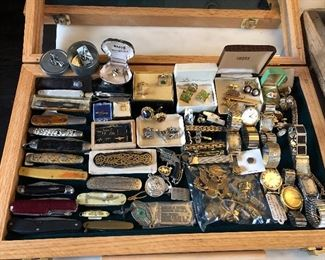 men's case includes pocket knives, cufflinks, watches, WWII insignias, uniform pins, etc.