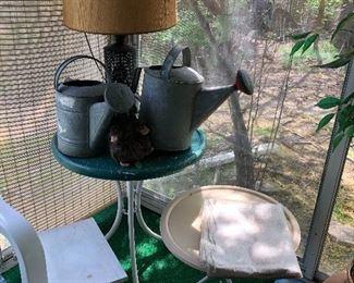 vintage metal patio tables & watering cans