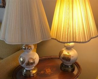 cute pair of retro ceramic lamps with gold fern accents and original scalloped shades