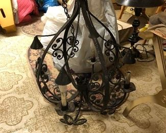 lots of cool retro lights at this house - vintage iron chandelier